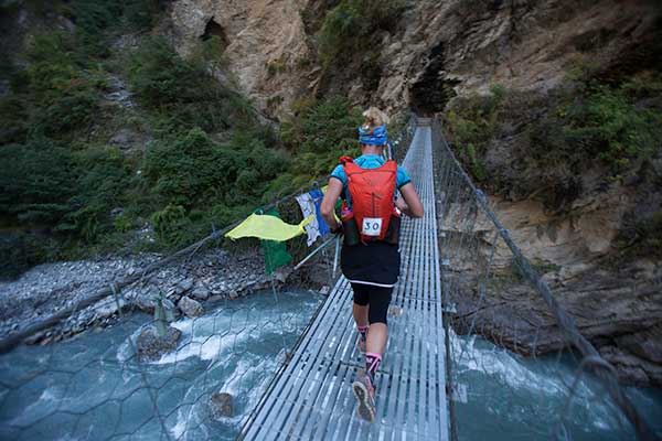 1 Here's Marta Poretti (IT) traversing one of the many suspension bridges which criss-cross the route.